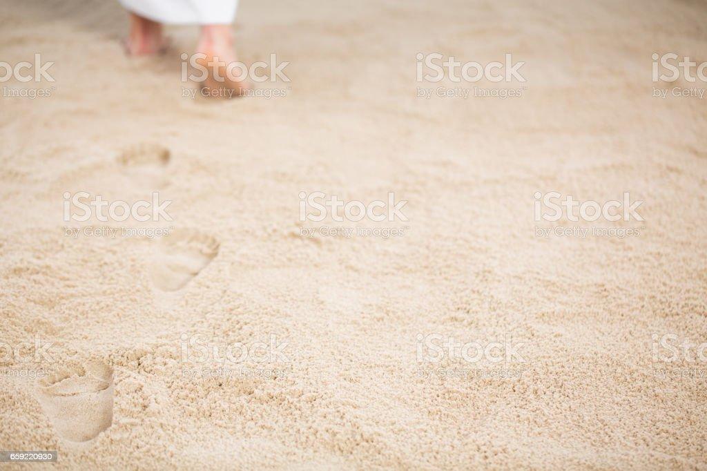Jesus leaving footprints in sand - Photo