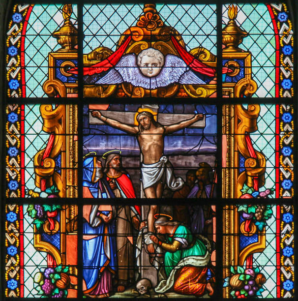 Jesus on the Cross - Stained Glass in Beguinage Church stock photo