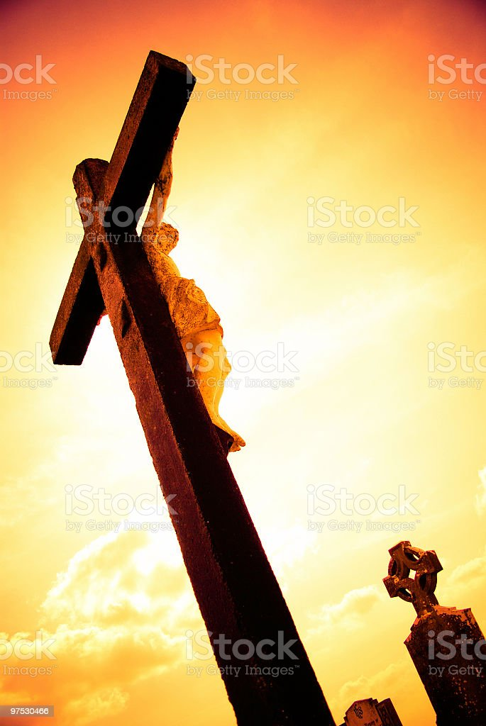 Jesus on the Cross with sunset colors in Irish cemetery royalty-free stock photo