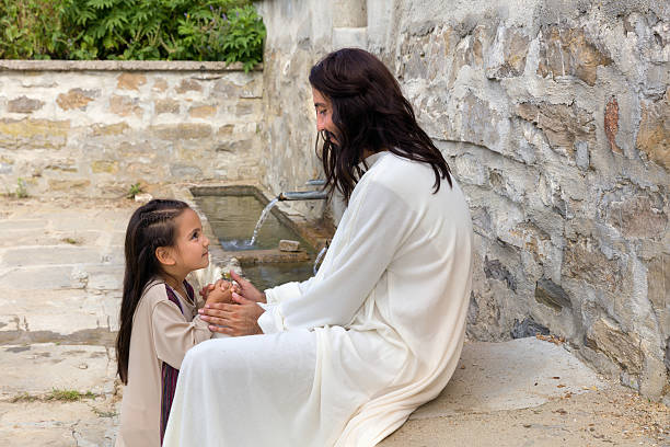 Jesus praying with a little girl stock photo