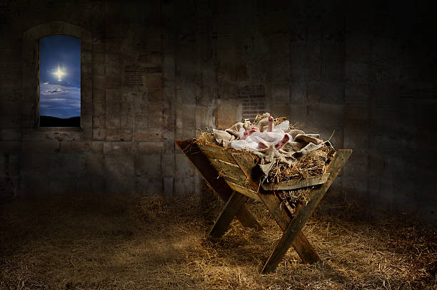jesus resting on a manger - nativity scene stock pictures, royalty-free photos & images