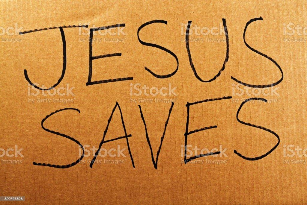 Jesus Saves Cardboard Sign stock photo