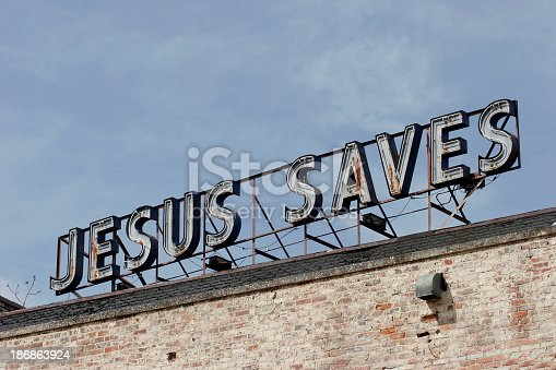 Old neon sign on top of an abondoned churchMore Charlotte Photos: