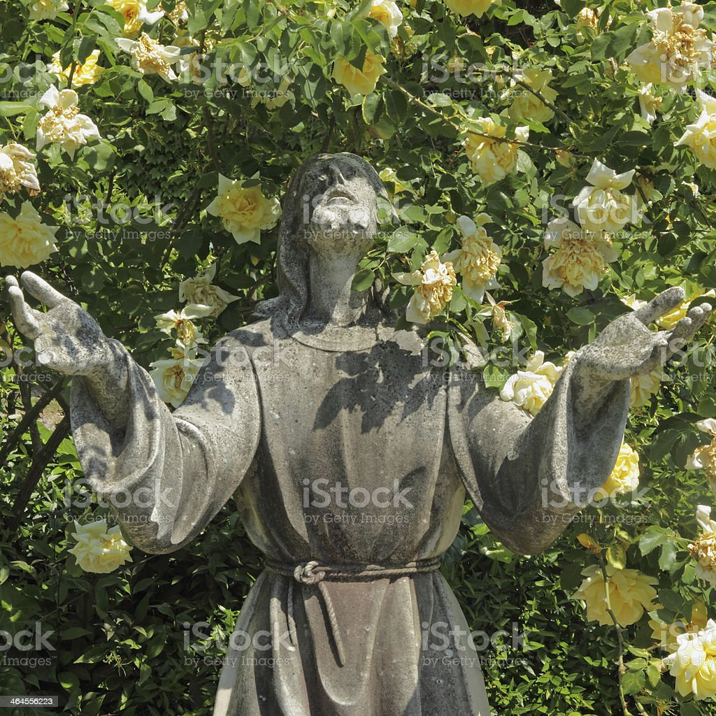 Jesus statue and roses stock photo