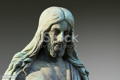 Bronze Jesus statue on a gradient background, clipping path included