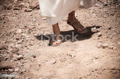 A man wearing old sandals and robe. Similar images: