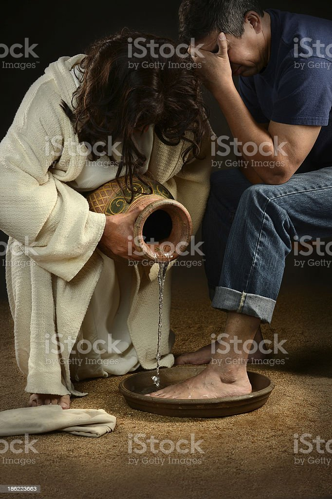 Jesus Washing Feet of Man stock photo