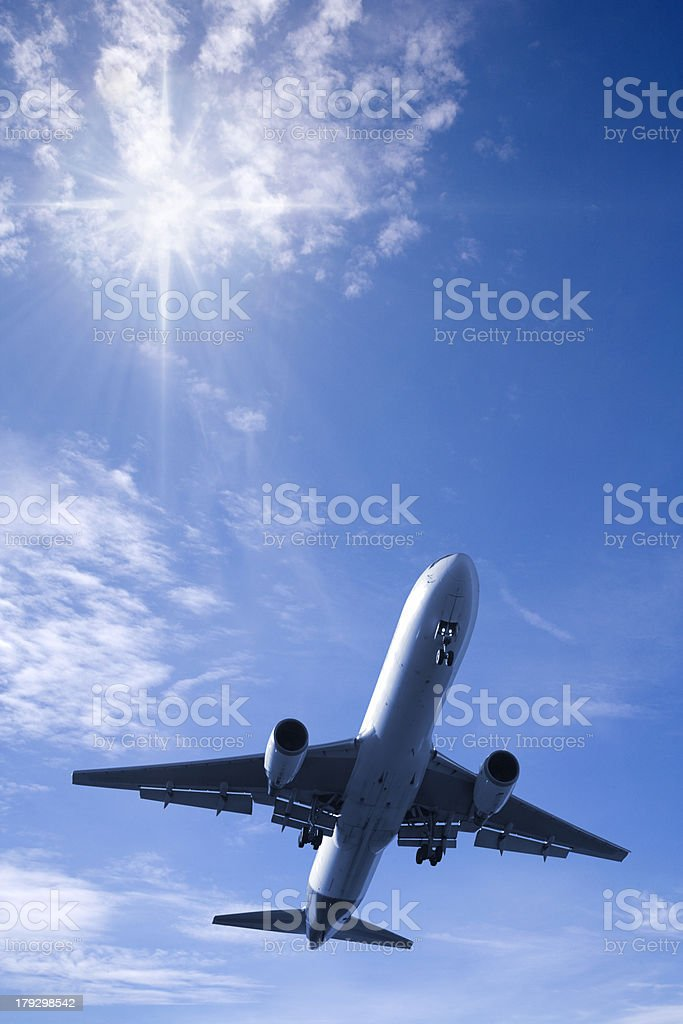 Jet Aeroplane in Bright Summer Sky Vertical royalty-free stock photo