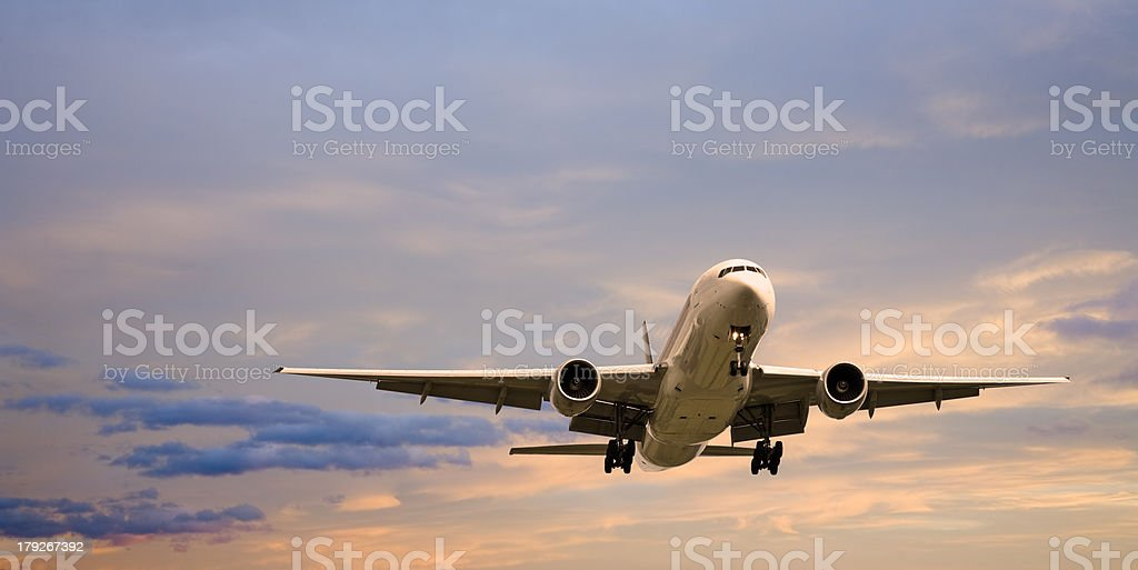 Jet Aeroplane Landing at Sunset stock photo