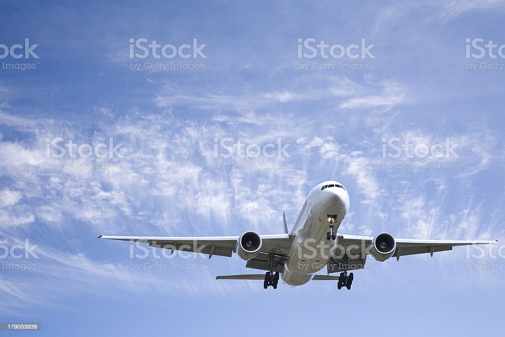 Jet Aeroplane Landing From Blue Summer Sky stock photo
