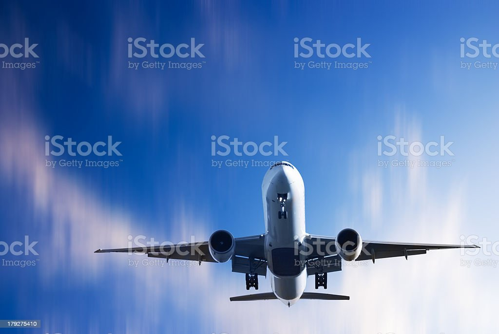 Jet Aeroplane Landing From Bright Twilight Motion Blur Sky stock photo