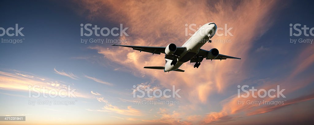 XXL Jet Aeroplane Landing from Bright Twilight Sky Panoramic stock photo