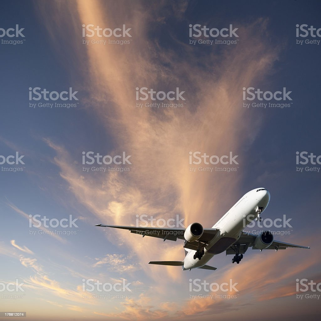 Jet Aeroplane Landing from Bright Twilight Sky Square stock photo