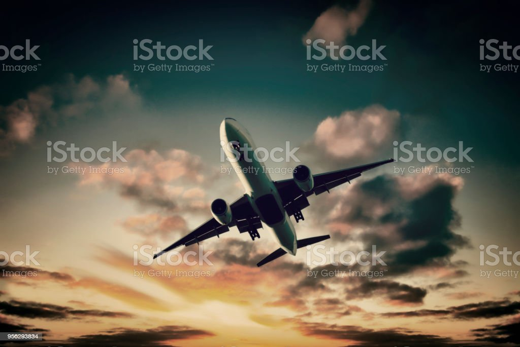 Jet Aeroplane Landing from Moodu Colorful Sky stock photo