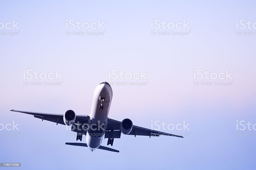 Jet Aeroplane Landing on Soft Misty Morning stock photo