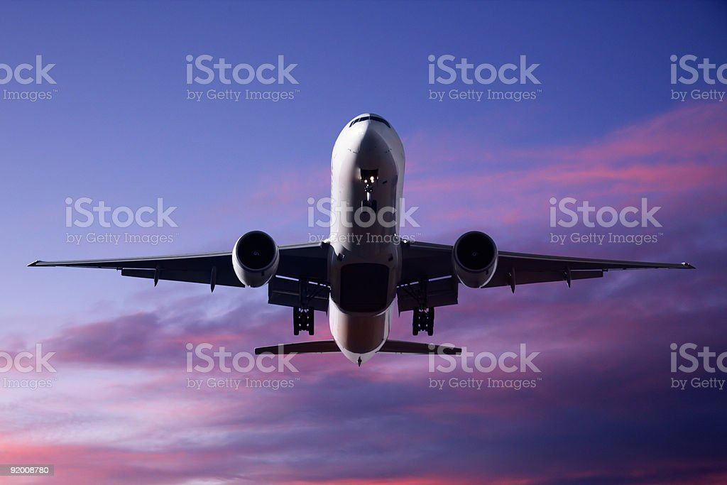 Jet Aeroplane Landing Sunset Blue Purple Red Twilight Sky stock photo