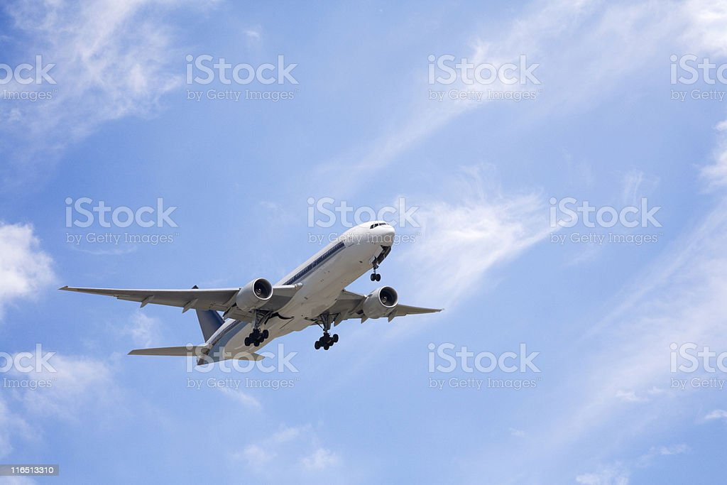 Jet Aeroplane Taking Off into Bright Sky stock photo
