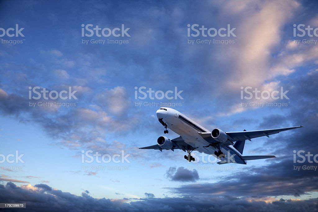 Jet Aeroplane Taking Off Into Bright Twilight Sky royalty-free stock photo