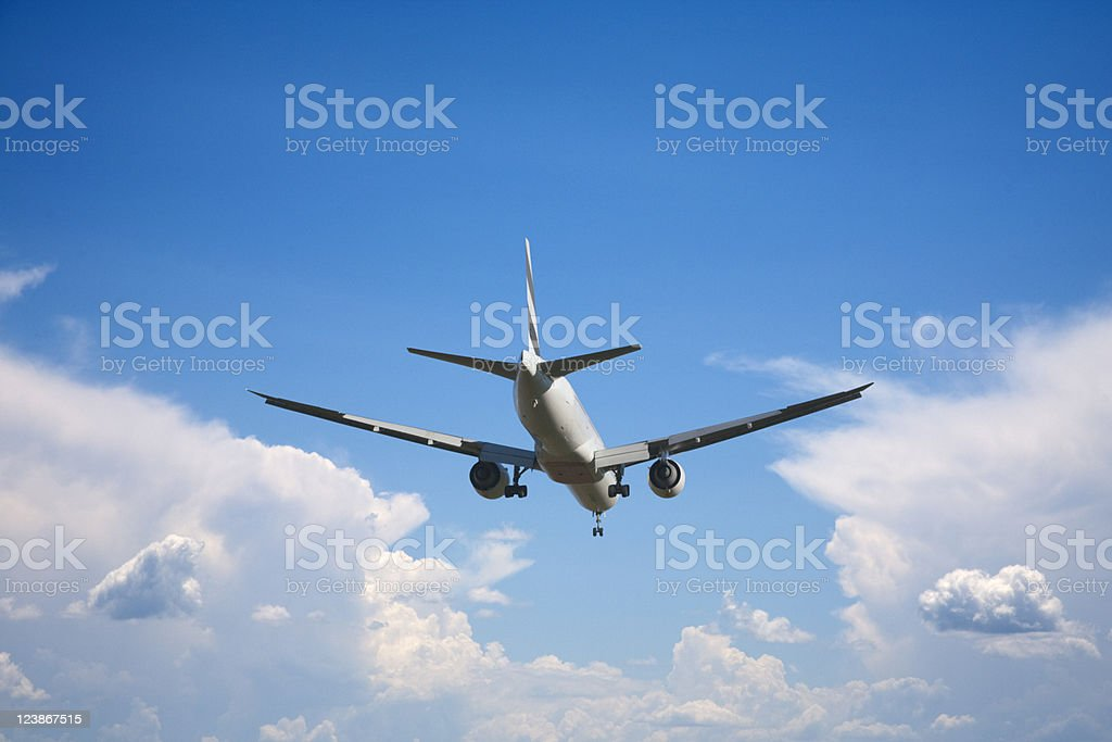 Jet Airliner About to Land, Cloud Background stock photo