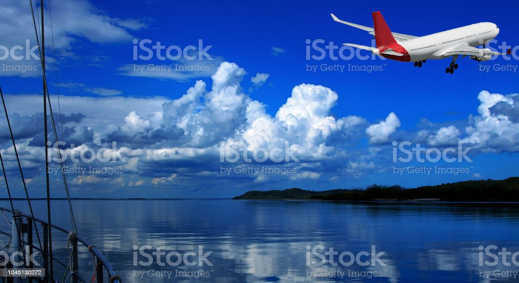Jet Airliner Flying in an blue coloured cumulonimbus cloudy sky. stock photo