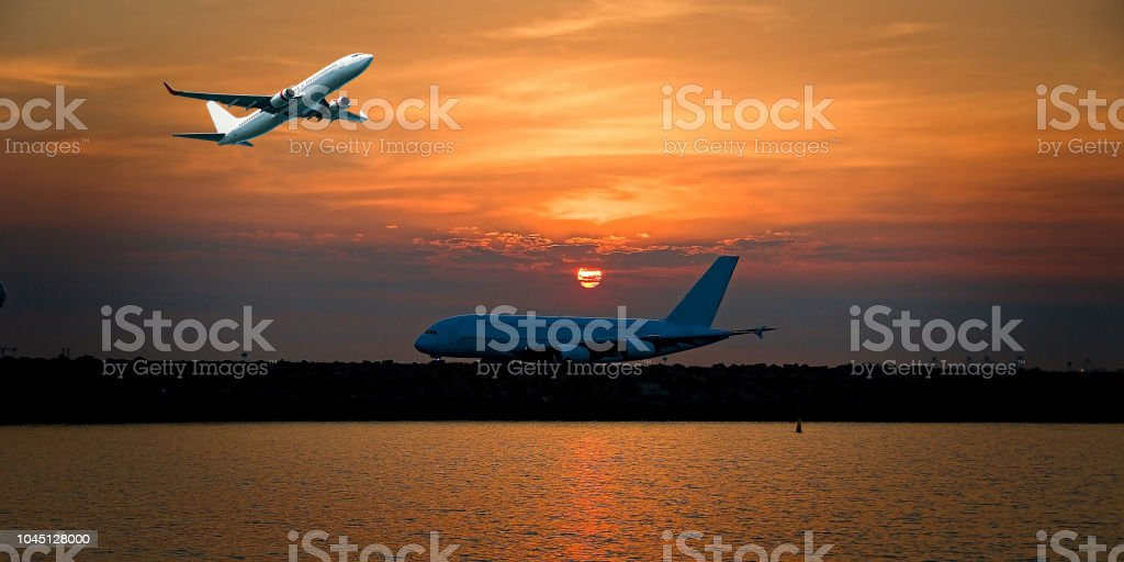 Jet Airliner Flying in an orange coloured cirrostratus cloudy sky. stock photo