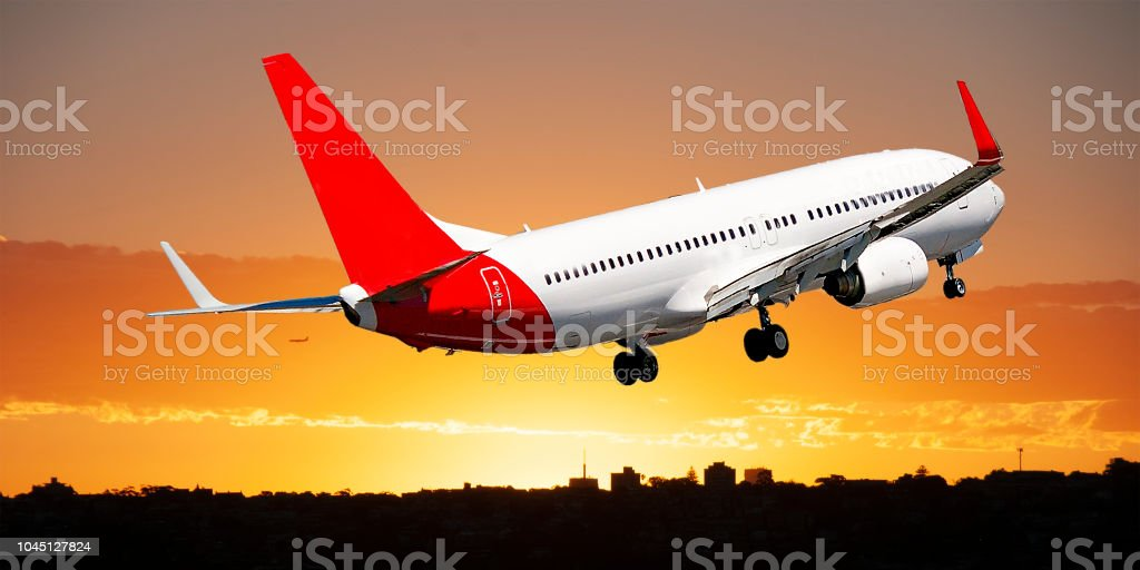 Jet Airliner Flying in an orange coloured stratus cloudy sky. stock photo