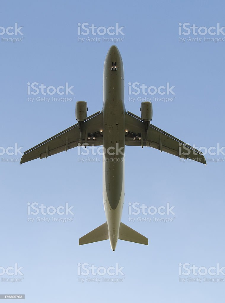 Jet airliner from bottom stock photo