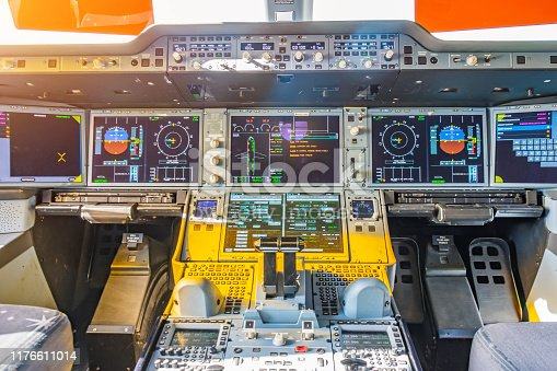Jet airliner plane view inside the cockpit of the engine control panel, thrust and the main dashboard