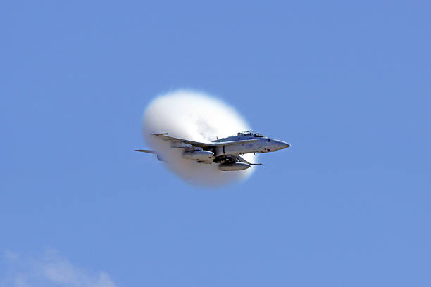 jet airplane f-18 hornet breaking speed of sound - sonic boom stock photos and pictures