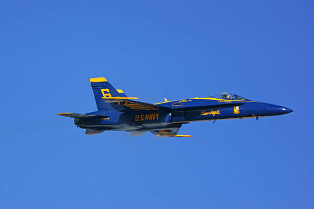 jet airplane f-18 hornet of the blue angels - sonic boom stock photos and pictures