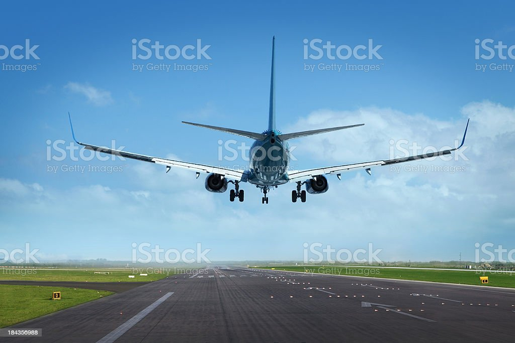 Jet airplane just landing stock photo