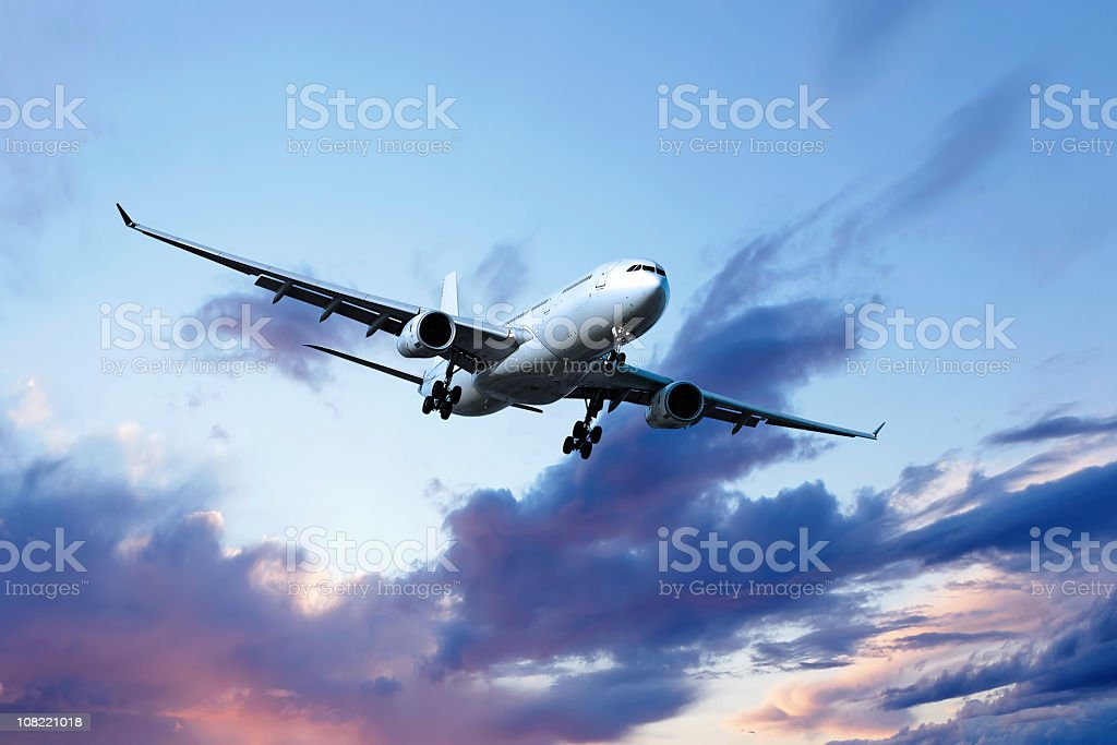 XL jet airplane landing at dusk royalty-free stock photo
