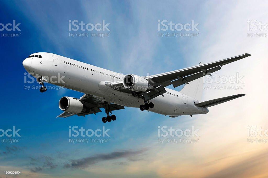 XXL jet airplane landing at dusk stock photo
