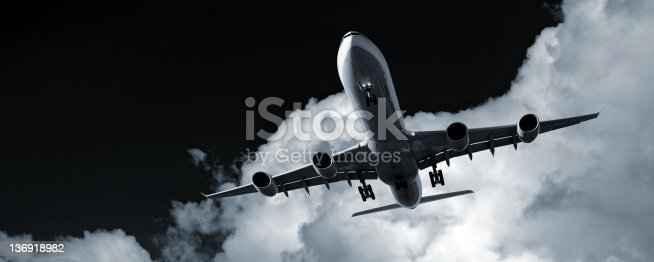 jet airplane landing at night with storm cloud, panoramic frame