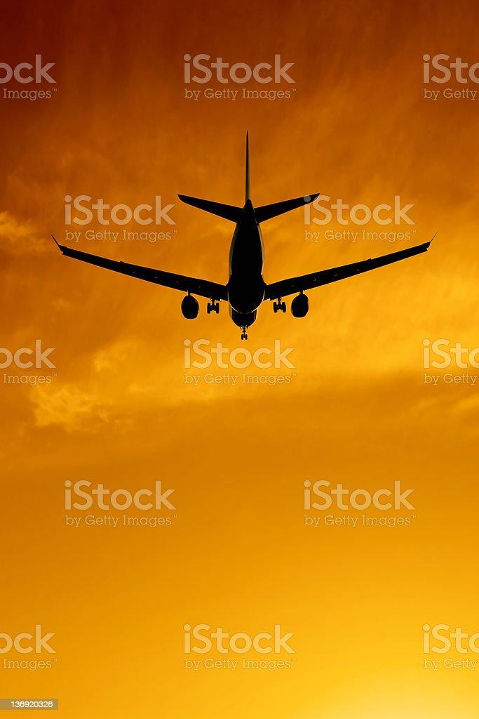 XXXL jet airplane landing at sunset royalty-free stock photo