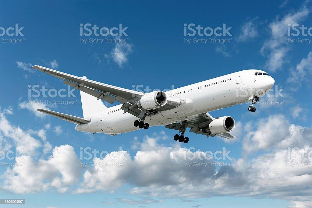 XXL jet airplane landing in bright sky royalty-free stock photo