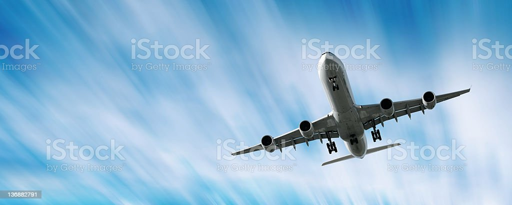 XXL jet airplane landing in motion blur sky royalty-free stock photo