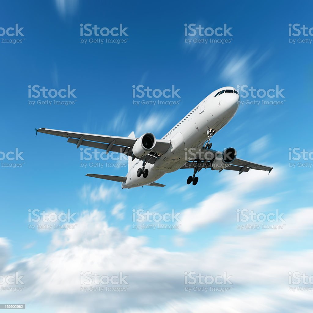 XL jet airplane landing in motion blur sky stock photo