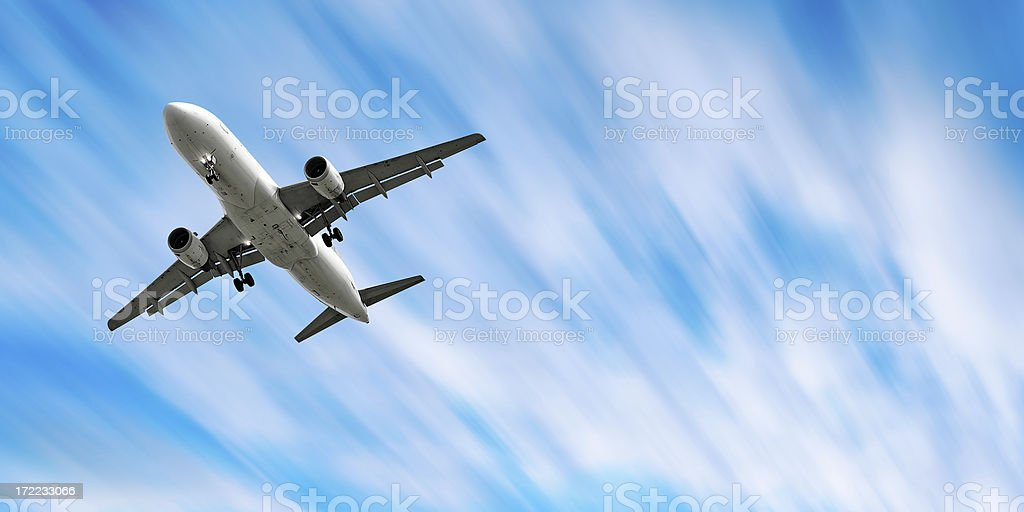 jet airplane landing in motion blur sky stock photo