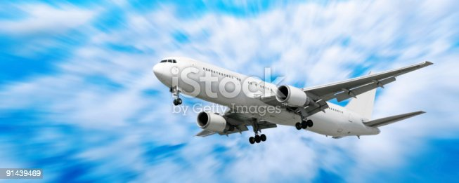 864534880 istock photo XXL jet airplane landing in motion blur sky 91439469