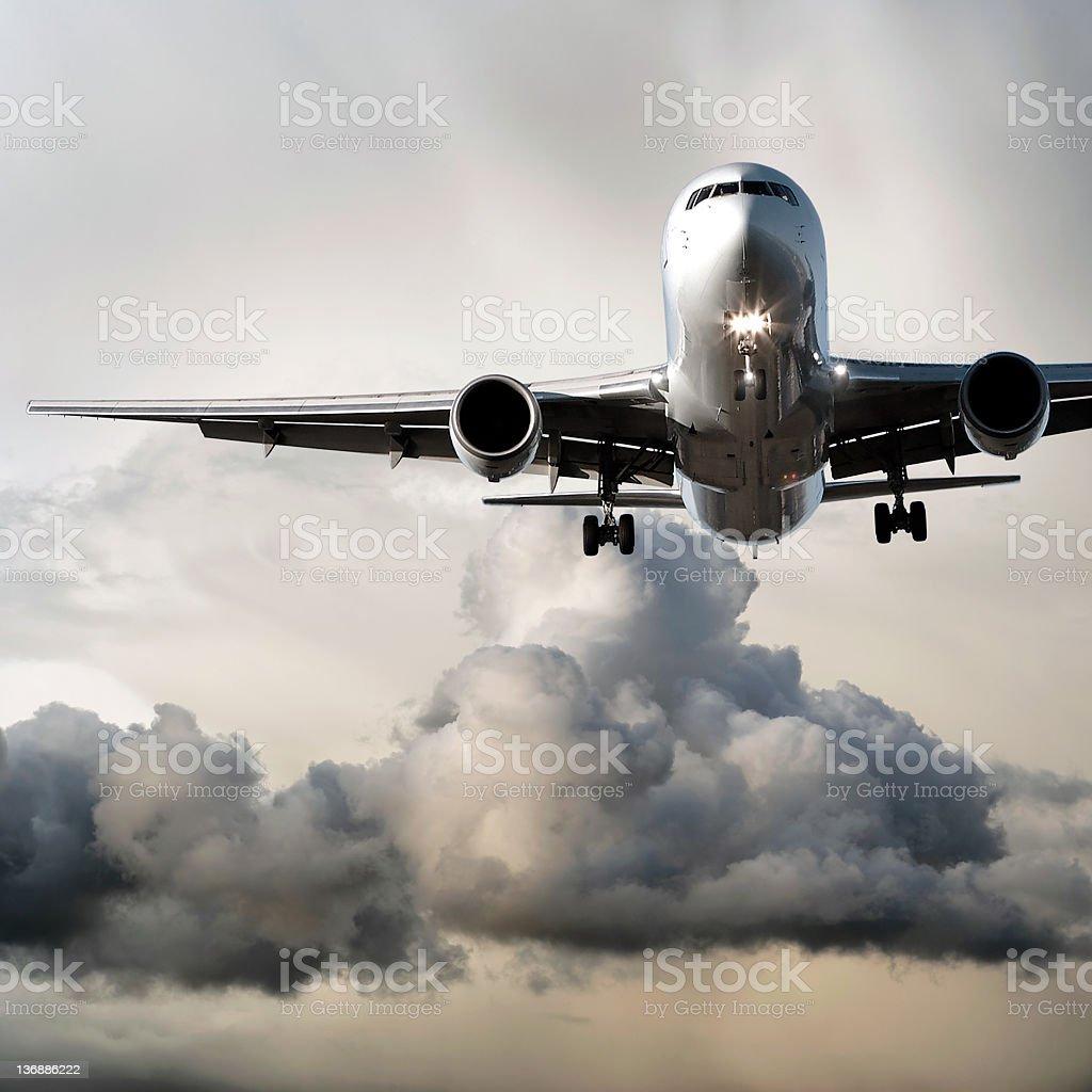 jet airplane landing in storm stock photo