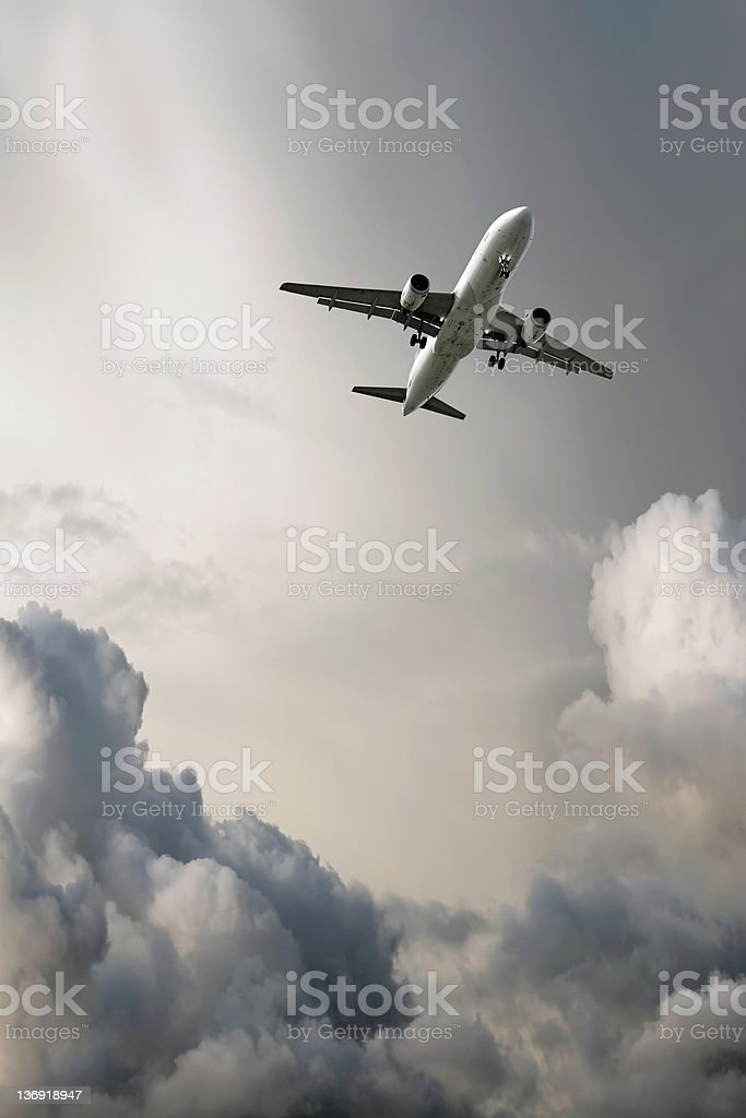 XL jet airplane landing in storm stock photo
