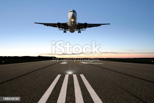 jet airplane landing on runway at twilight (XXL)