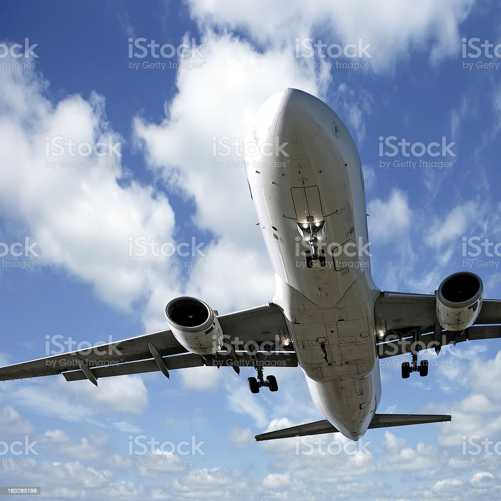 jet airplane landing stock photo