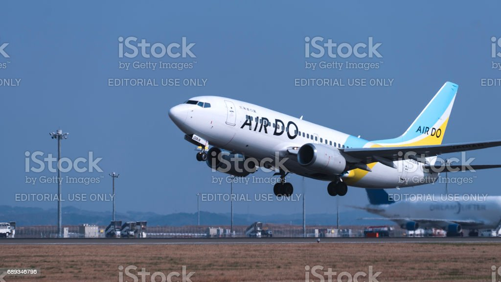 Jet airplane landing to an airport stock photo