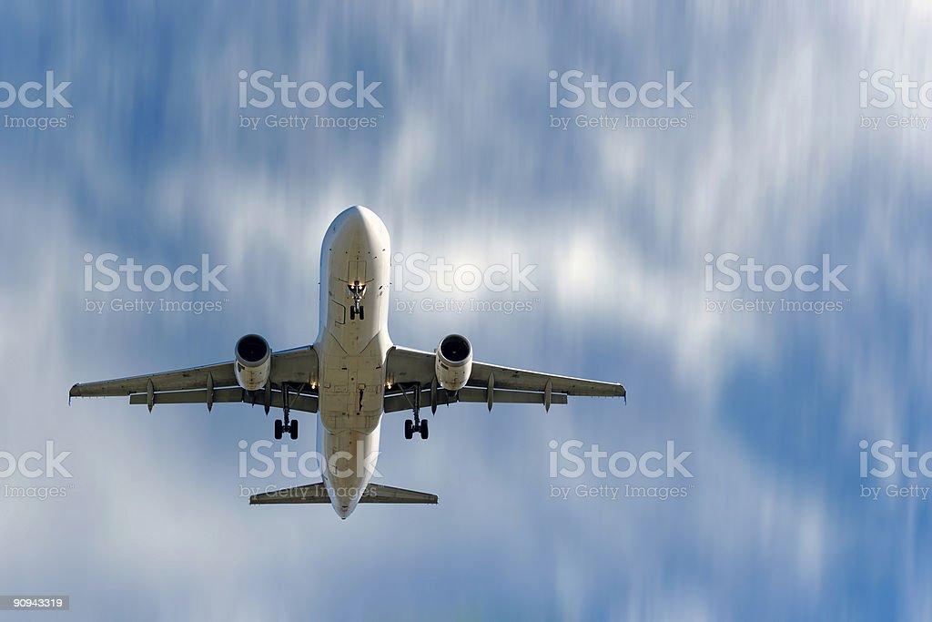 XL jet airplane landing with motion blur stock photo