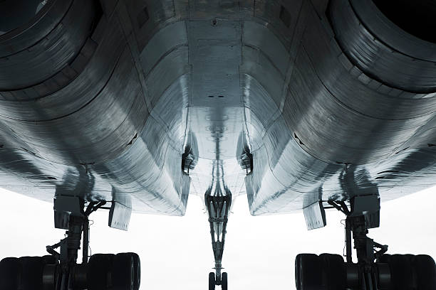 Jet Airplane, Low angle View abstract view of an airplane seen from below,  supersonic airplane stock pictures, royalty-free photos & images