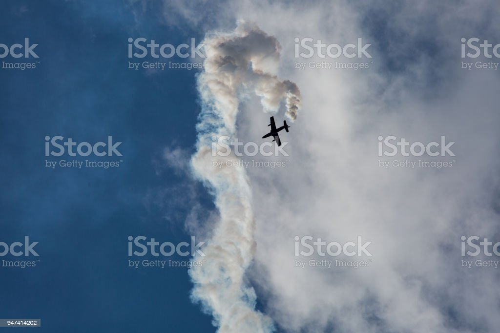 Jet airplane on airshow with smoke and trails stock photo