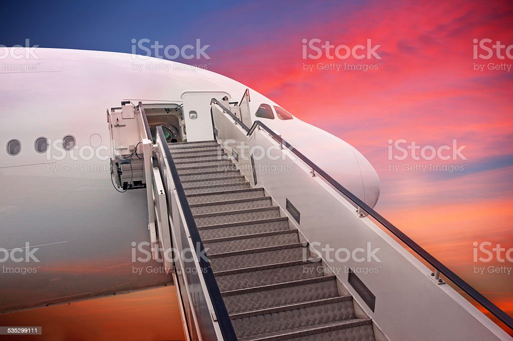 Captivating Jet Airplane Stairs At Sunset Stock Photo