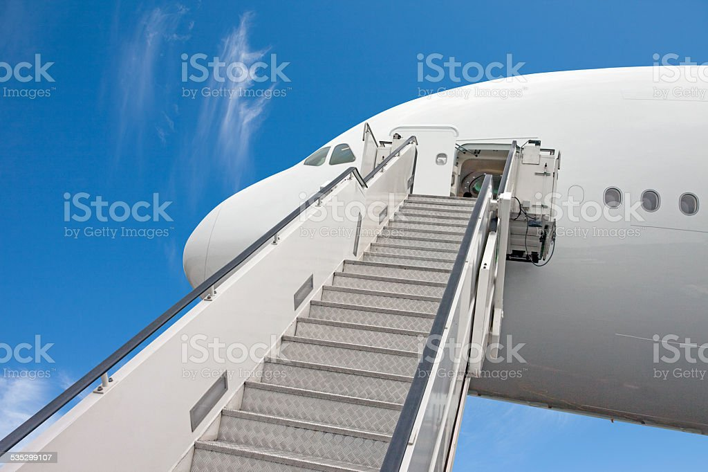 Jet Airplane Stairs, Blue Sky Royalty Free Stock Photo